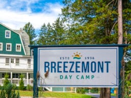 An exterior view of the front entrance to Breezemont camp.