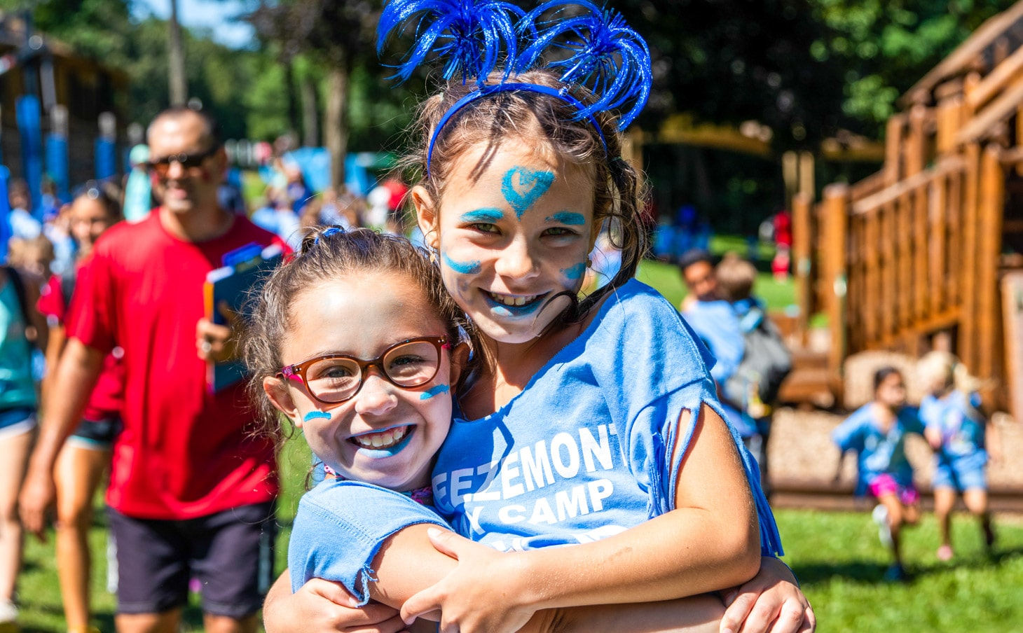 Campers dressed up in face paint for a celebration.