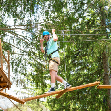 A person using the zipline at Breezemont Day Camp.