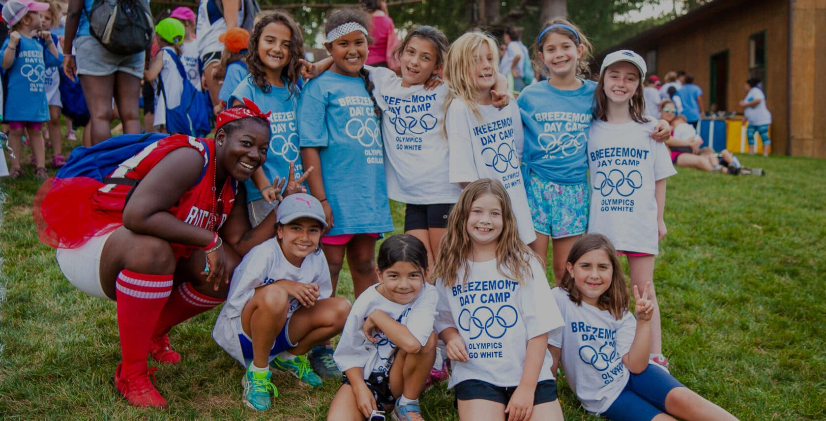 Group of campers smiling and posing for the camera during the olympics event.