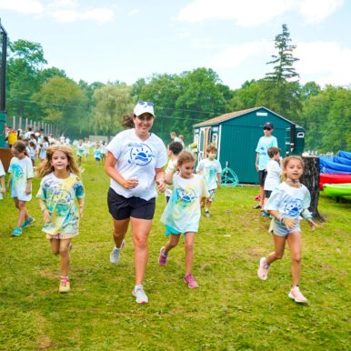 Campers running and smiling.