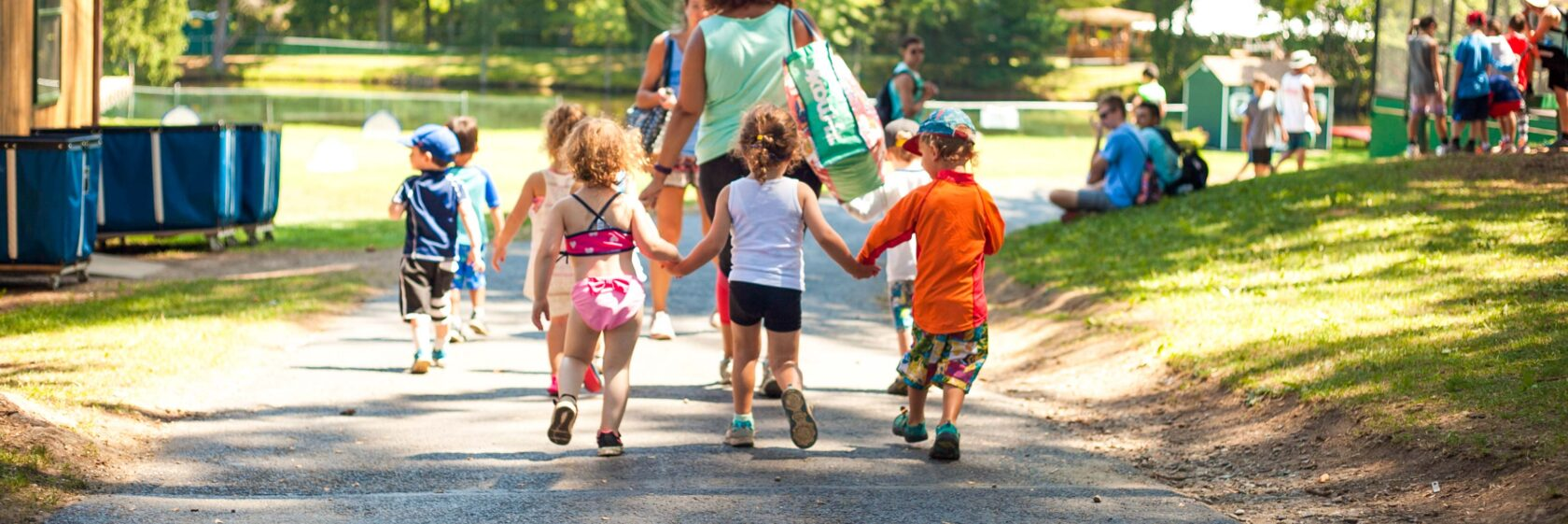 Campers walking together and holding hands.