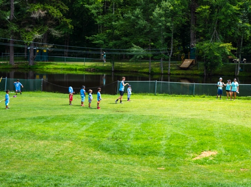 Campers playing soccer on the soccer fields.