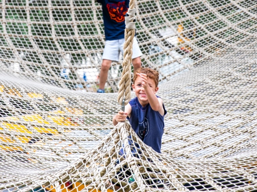Campers playing on the ropes course.