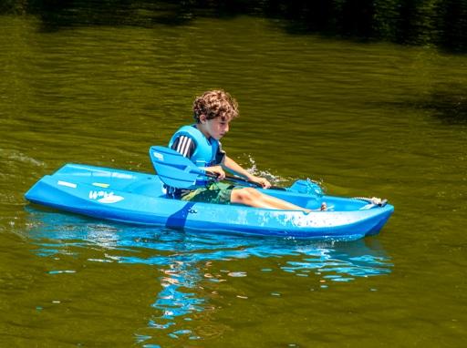 A camper kayaking in the lake.