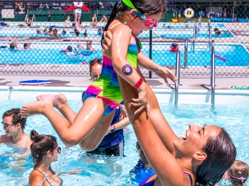 Campers having fun in the pool.