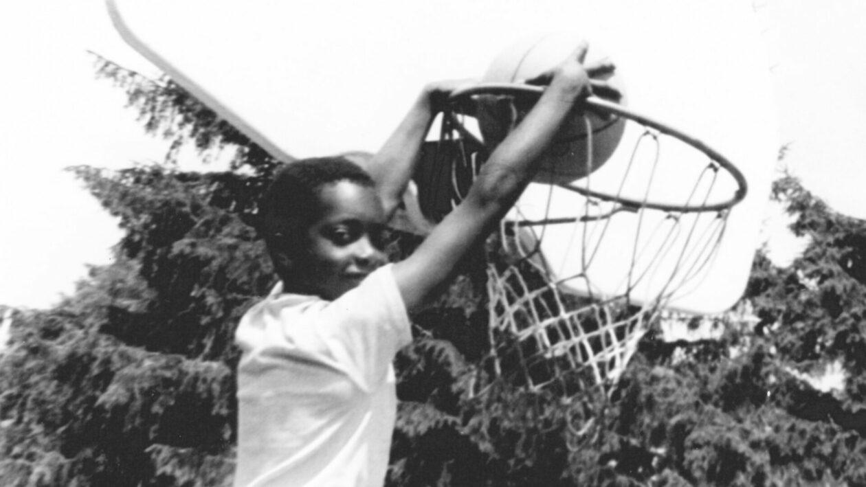 A camper dunking a basketball.