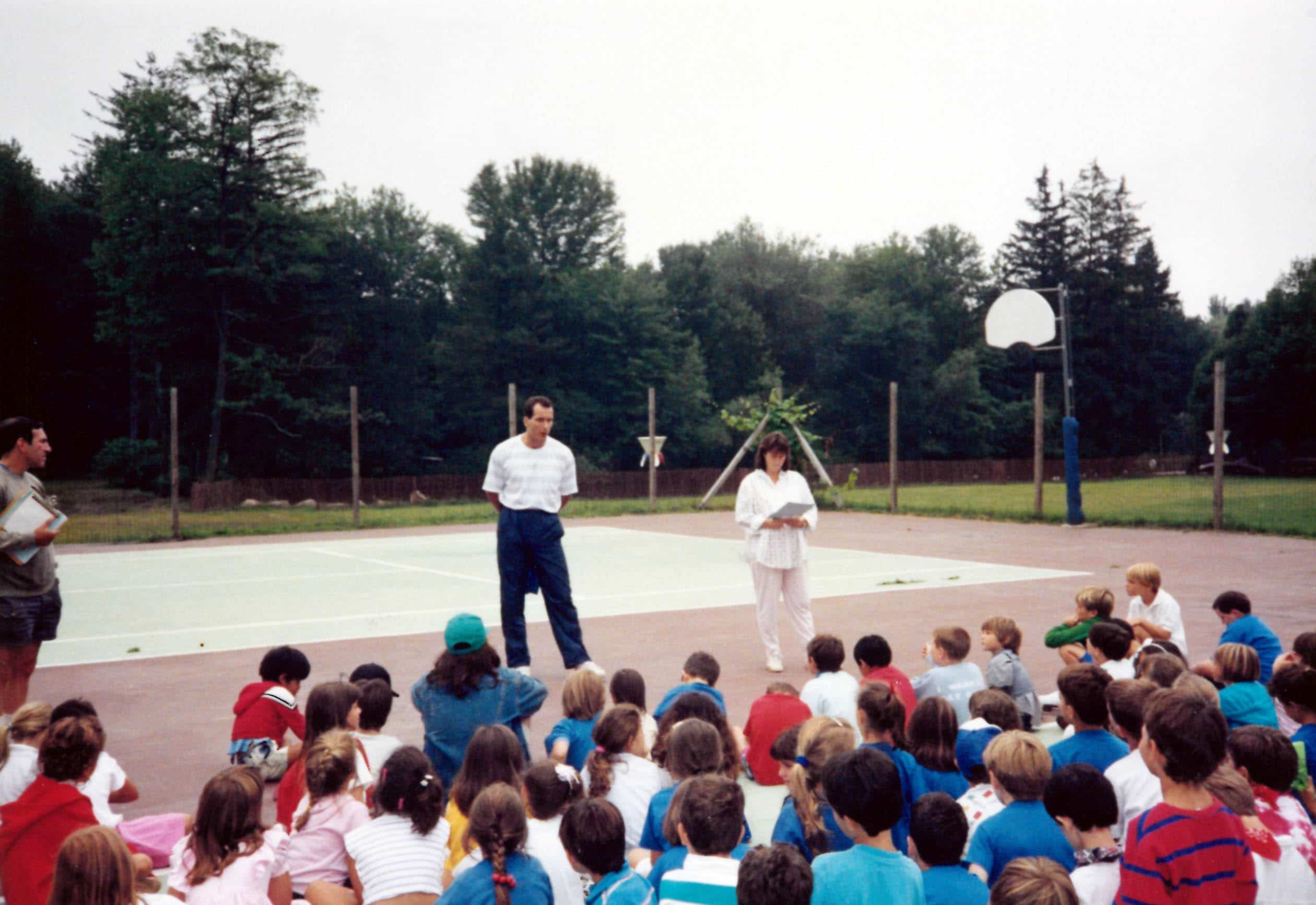 Campers listening during a camp assembly.