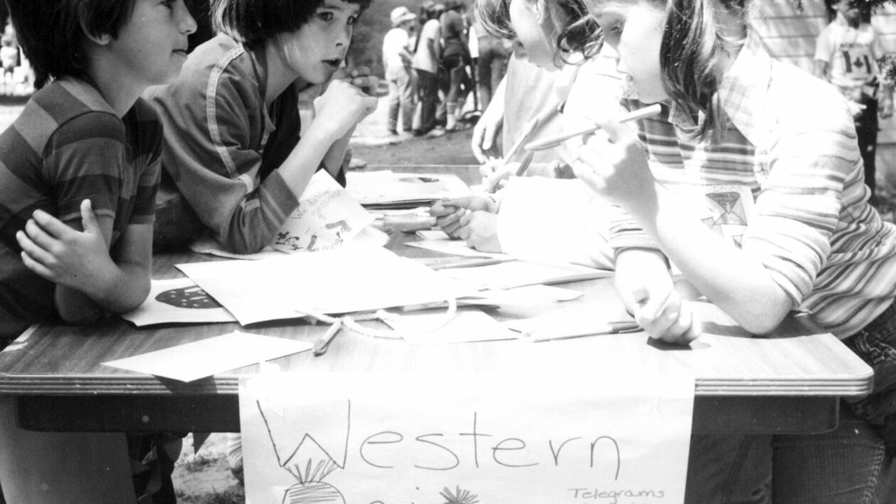 Campers writing telegrams as part of a camp activity.