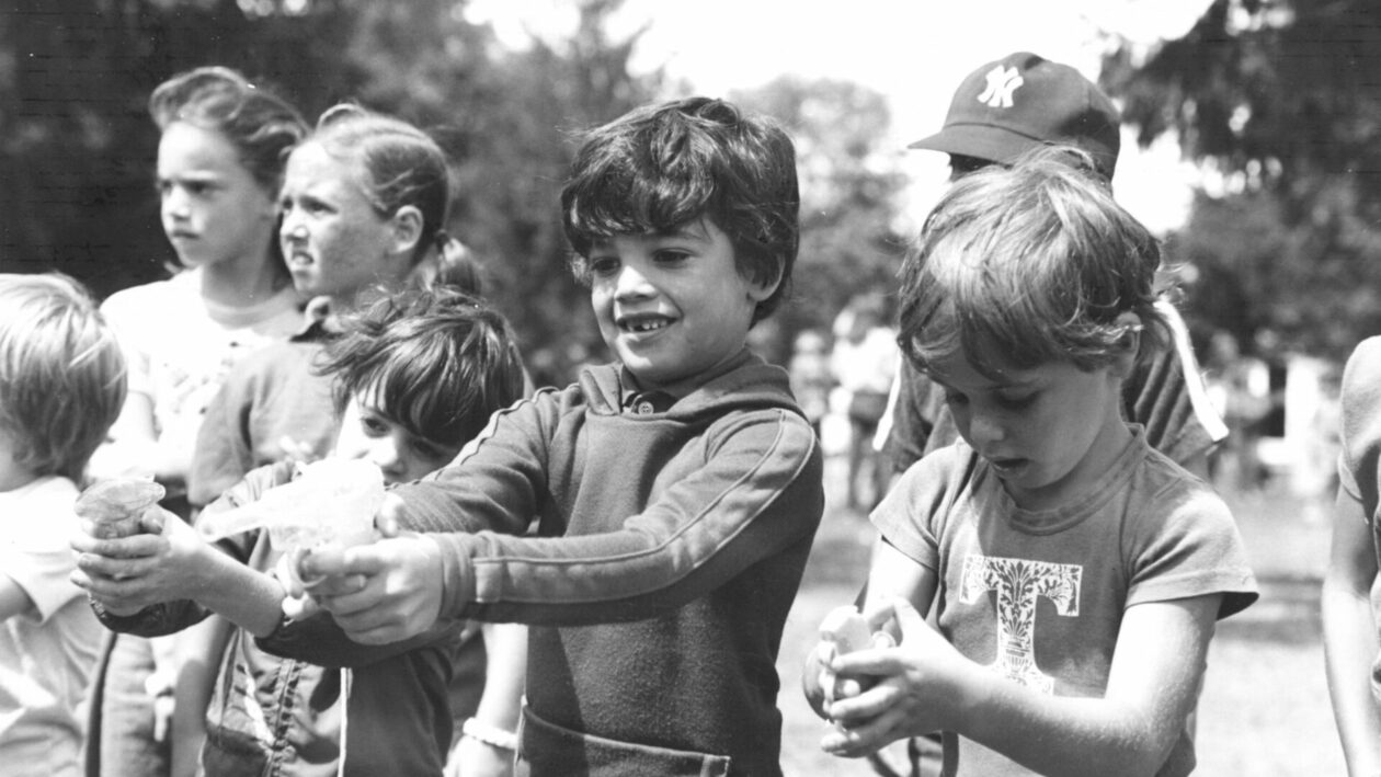 Campers playing with water guns.