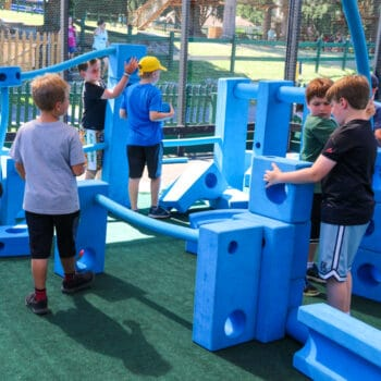 Campers playing in the imagination playground.