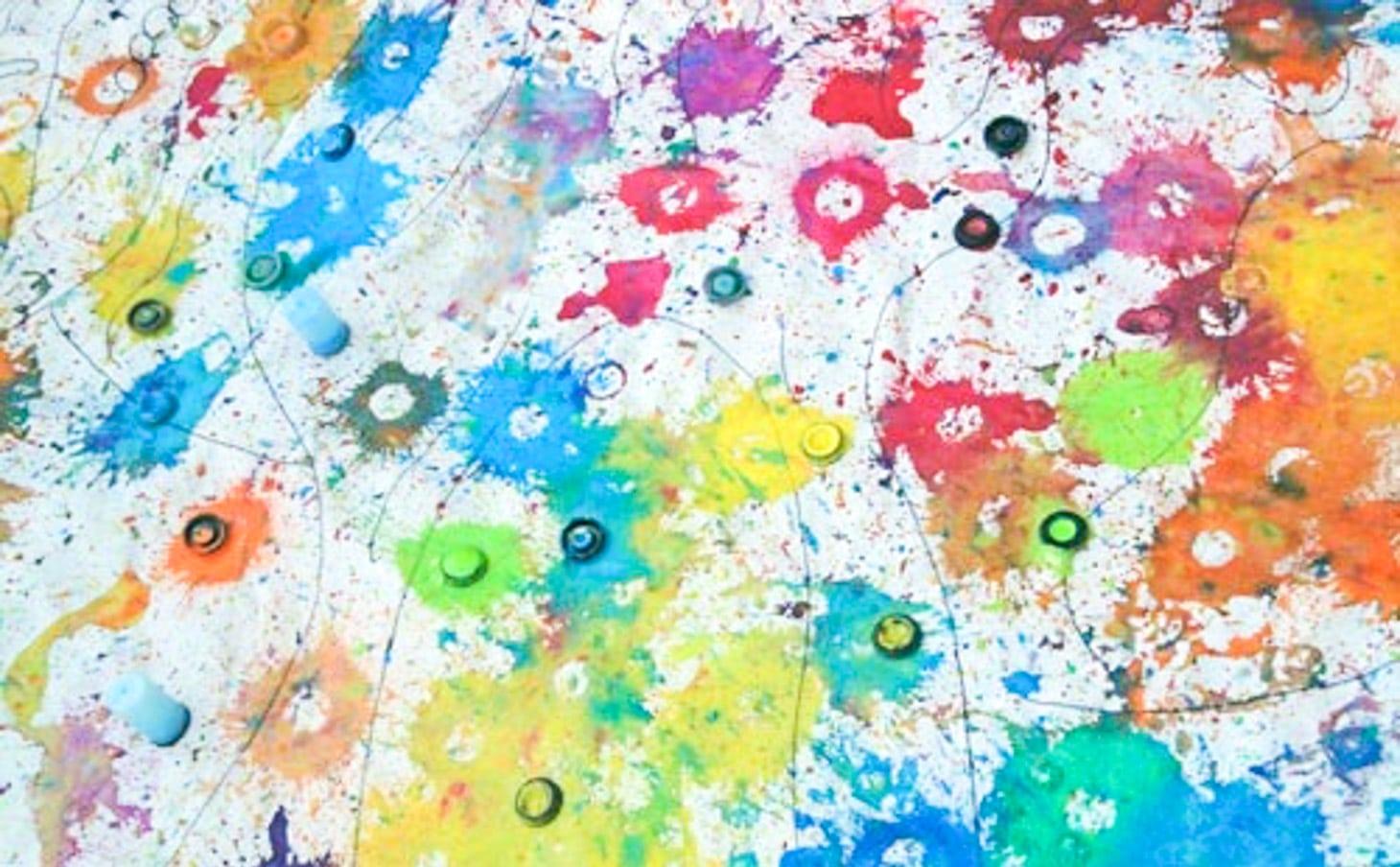Paint splatters on a canvas.