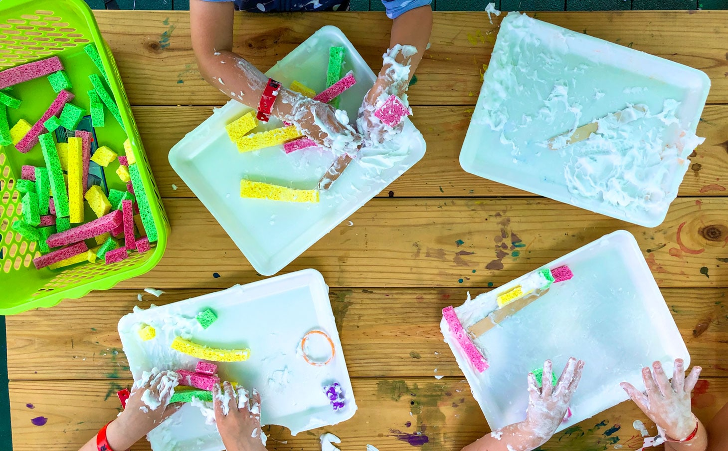 Campers making messy art work and having fun.