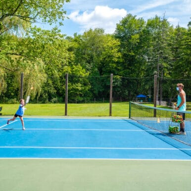Campers playing tennis.