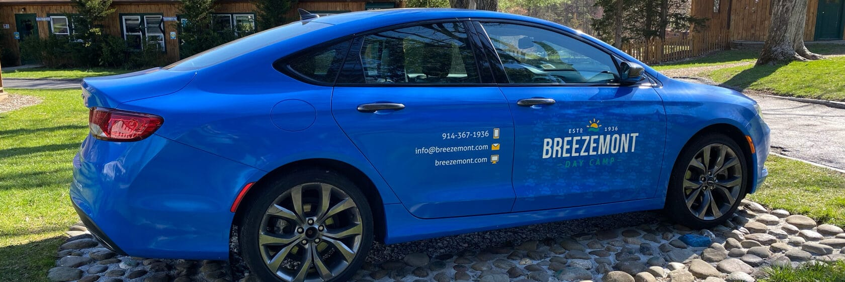 Our specially wrapped car with Breezemont Logo in blue